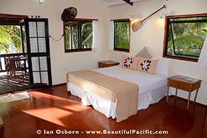 King bed in the absolute beach bungalow